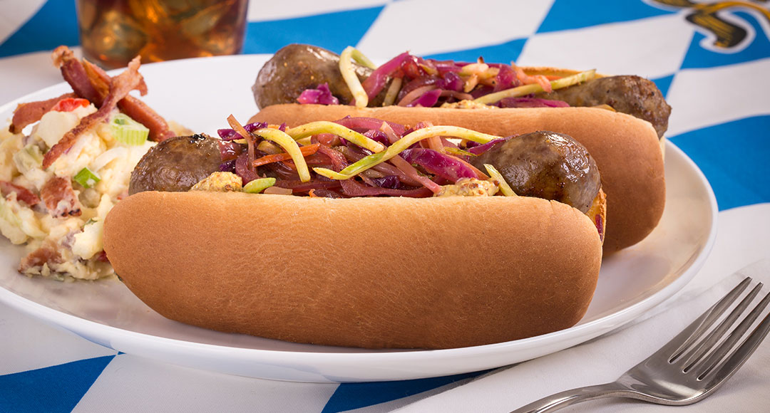 Ball Park's Grilled Brats topped with Quick-Cooked Cabbage and served with German potato salad