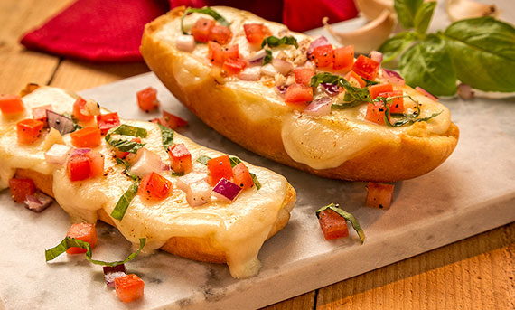 Ball Park Bun's Easy Cheesy Garlic Bread, with tomatoes, red onions and basil